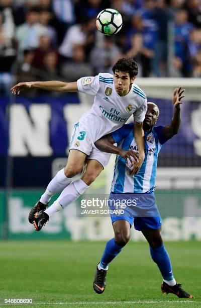Real Madrid's Spanish defender Jesus Vallejo vies with Malaga's Nigerian forward Brown Ideye during the Spanish league footbal match between Malaga...