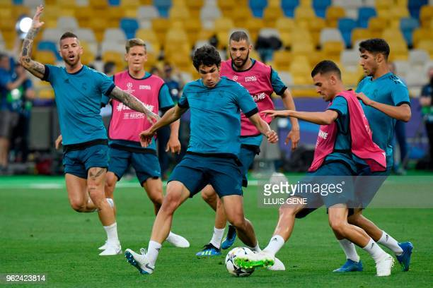 Real Madrid's Spanish defender Jesus Vallejo vies with Real Madrid's French defender Theo Hernandez during a team's training session at the Olympic...