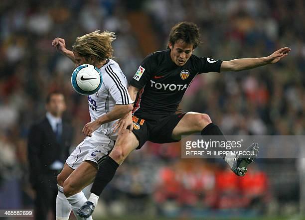 Real Madrid's Spanish defender Michel Salgado vies with Valencia's Spanish midfielder Silva during their Liga football match at Santiago Bernabeu...