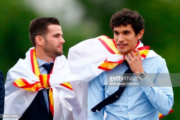 Real Madrid's Spanish defender Nacho Fernandez and Real Madrid's Spanish defender Jesus Vallejo celebrate at Cibeles square in Madrid on May 27 2018...