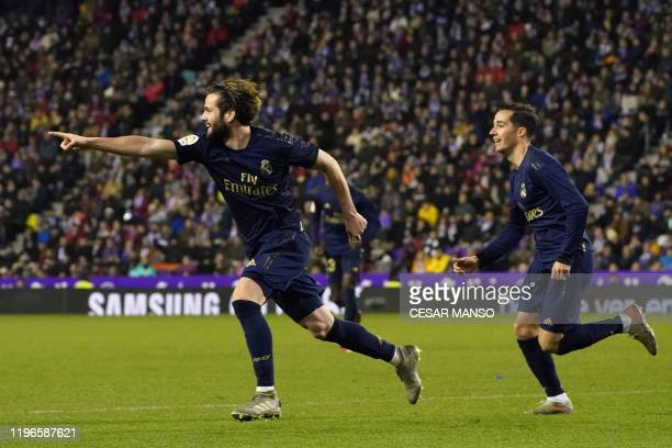 Real Madrid's Spanish defender Nacho Fernandez celebrates after scoring a goal during the Spanish league football match Real Valladolid FC against...