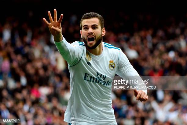 Real Madrid's Spanish defender Nacho Fernandez celebrates after scoring a goal during the Spanish league football match between Real Madrid and...