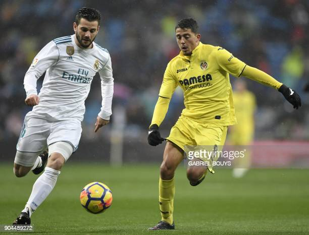 Real Madrid's Spanish defender Nacho Fernandez challenges Villarreal's Spanish midfielder Pablo Fornals during the Spanish league football match...
