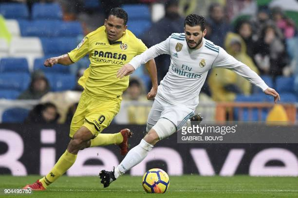Real Madrid's Spanish defender Nacho Fernandez challenges Villarreal's Colombian forward Carlos Bacca during the Spanish league football match...