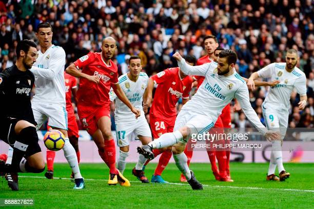 Real Madrid's Spanish defender Nacho Fernandez scores a goal during the Spanish league football match between Real Madrid and Sevilla at the Santiago...