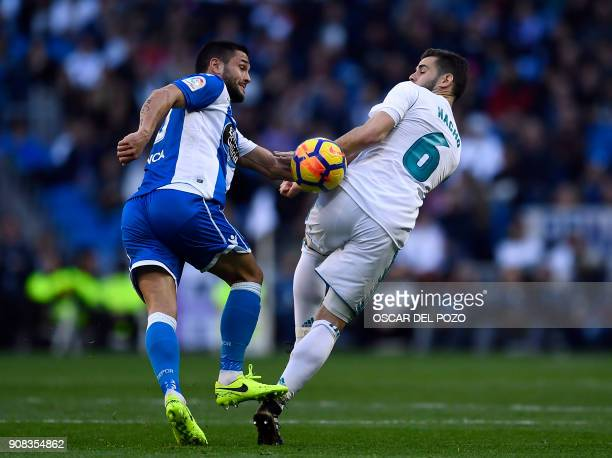Real Madrid's Spanish defender Nacho Fernandez vies with Deportivo La Coruna's Romanian forward Florin Andone during the Spanish league football...