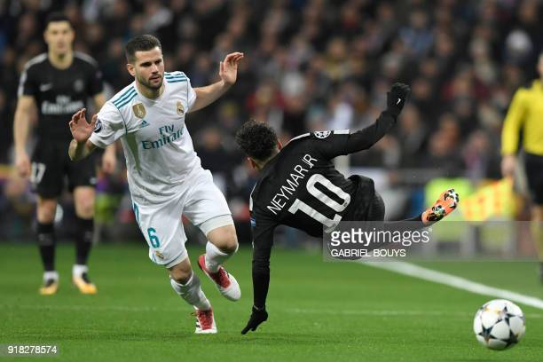 TOPSHOT Real Madrid's Spanish defender Nacho Fernandez vies with Paris SaintGermain's Brazilian forward Neymar during the UEFA Champions League round...