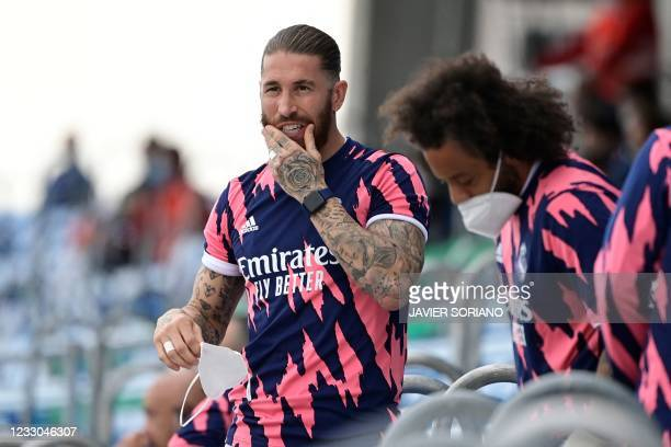 Real Madrid's Spanish defender Sergio Ramos and Real Madrid's Brazilian defender Marcelo look on from the stand during the Spanish league football...