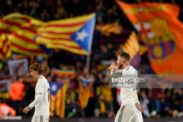Real Madrid's Spanish defender Sergio Ramos and Real Madrid's Croatian midfielder Luka Modric leave the pitch at the end of the Spanish league...