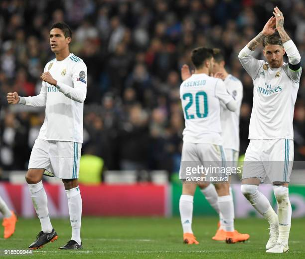 Real Madrid's Spanish defender Sergio Ramos and Real Madrid's French defender Raphael Varane celebrate their victory at the end of the UEFA Champions...