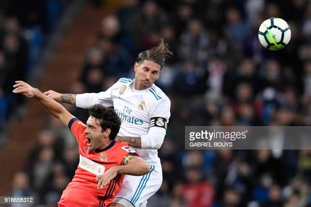 Real Madrid's Spanish defender Sergio Ramos and Real Sociedad's Spanish midfielder Xabier Prieto jump for the ball during the Spanish league football...