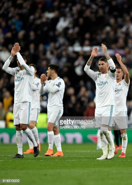 Real Madrid's Spanish defender Sergio Ramos and teammates celebrate their victory at the end of the UEFA Champions League round of sixteen first leg...