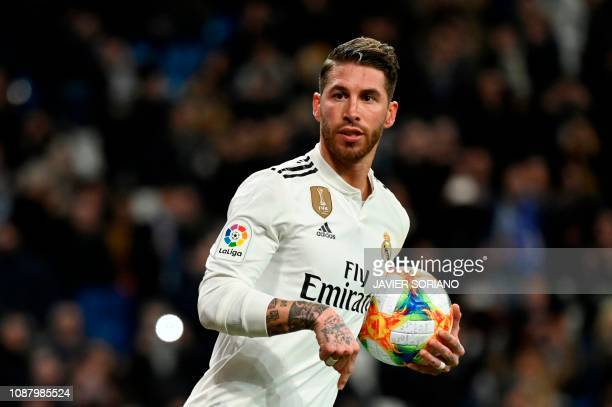 Real Madrid's Spanish defender Sergio Ramos celebrates after scoring a penalty during the Spanish Copa del Rey quarterfinal first leg football match...