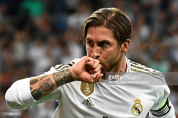 Real Madrid's Spanish defender Sergio Ramos celebrates after scoring a goal during the UEFA Champions league Group A football match between Real...