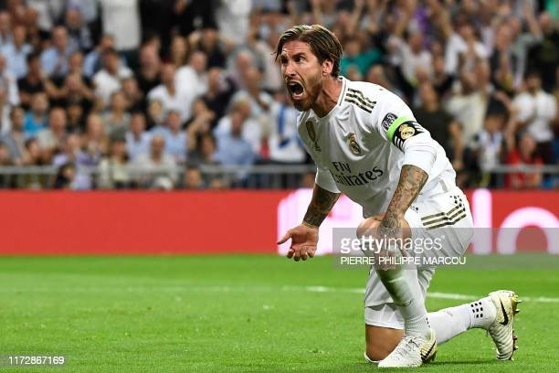 TOPSHOT Real Madrid's Spanish defender Sergio Ramos celebrates after scoring a goal during the UEFA Champions league Group A football match between...