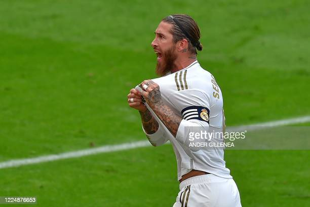 Real Madrid's Spanish defender Sergio Ramos celebrates after scoring a goal during the Spanish League football match between Athletic Club Bilbao and...