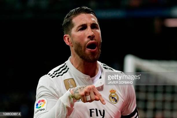 Real Madrid's Spanish defender Sergio Ramos celebrates after scoring during the Spanish Copa del Rey quarterfinal first leg football match between...
