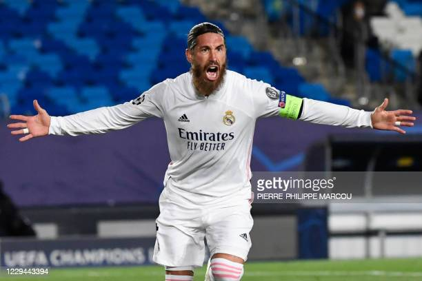 Real Madrid's Spanish defender Sergio Ramos celebrates his goal during the UEFA Champions League group B football match between Real Madrid and Inter...