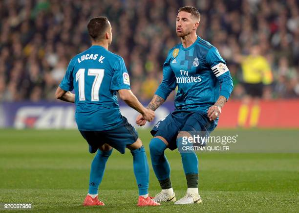 Real Madrid's Spanish defender Sergio Ramos celebrates scoring a goal with Real Madrid's Spanish midfielder Lucas Vazquez during the Spanish league...