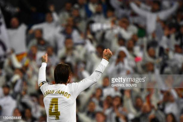 Real Madrid's Spanish defender Sergio Ramos celebrates with fans during the Spanish League football match between Real Madrid and Barcelona at the...