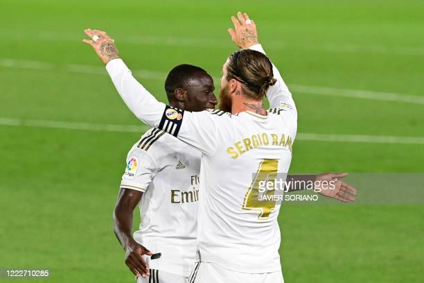 Real Madrid's Spanish defender Sergio Ramos celebrates with Real Madrid's French defender Ferland Mendy after scoring during the Spanish league...