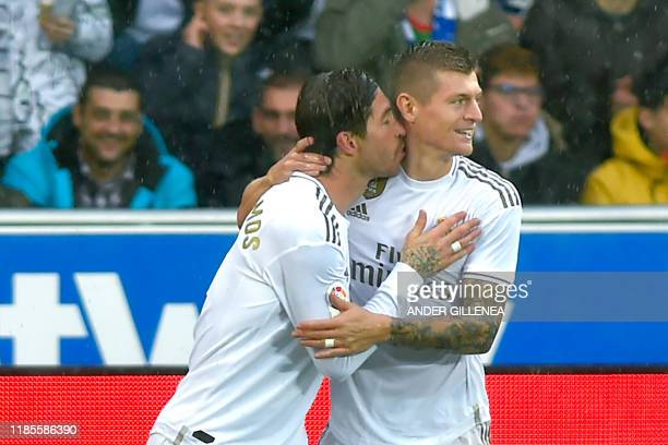 Real Madrid's Spanish defender Sergio Ramos celebrates with teammate Real Madrid's German midfielder Toni Kroos after scoring a goal during the...