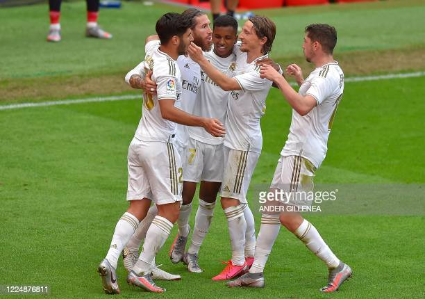 Real Madrid's Spanish defender Sergio Ramos celebrates with teammates after scoring a goal during the Spanish League football match between Athletic...