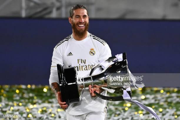 Real Madrid's Spanish defender Sergio Ramos celebrates with the trophy after winning the Liga title after the Spanish League football match between...