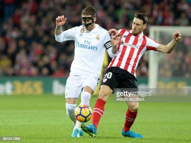 Real Madrid's Spanish defender Sergio Ramos challenges Athletic Bilbao's Spanish forward Aritz Aduriz during the Spanish league football match...