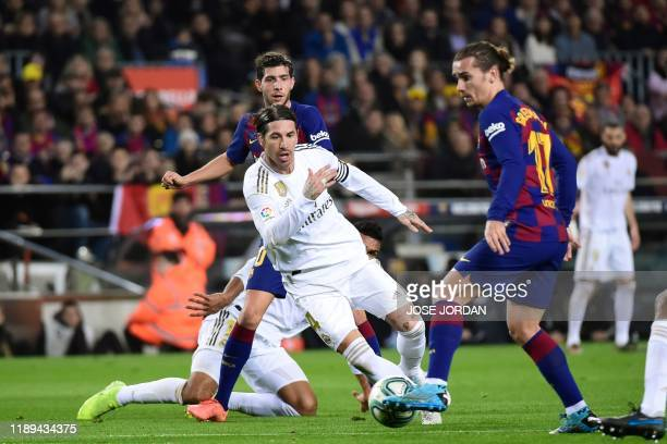 Real Madrid's Spanish defender Sergio Ramos challenges Barcelona's French forward Antoine Griezmann during the El Clasico Spanish League football...
