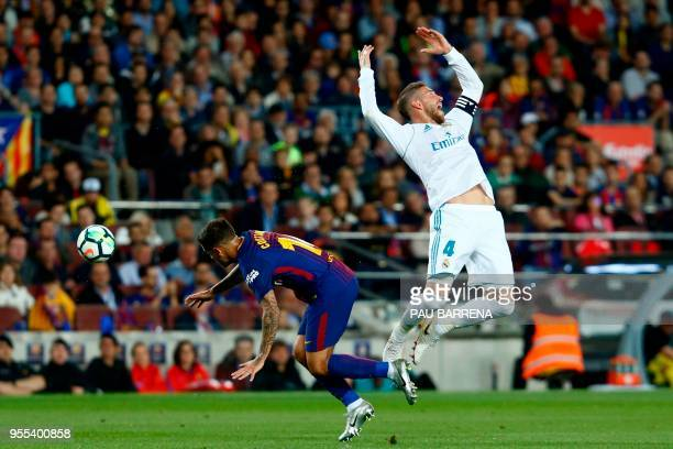 Real Madrid's Spanish defender Sergio Ramos challenges Barcelona's Brazilian midfielder Philippe Coutinho during the Spanish league football match...