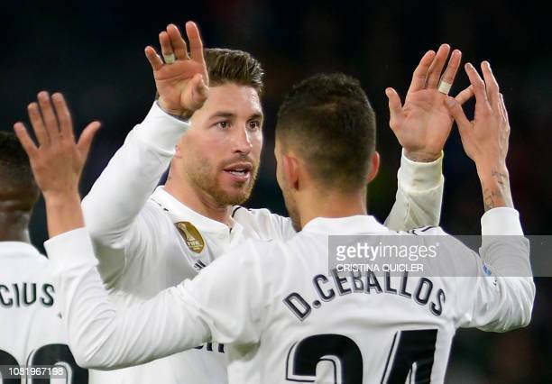 Real Madrid's Spanish defender Sergio Ramos congratulates Real Madrid's Spanish midfielder Daniel Ceballos for his goal during the Spanish League...