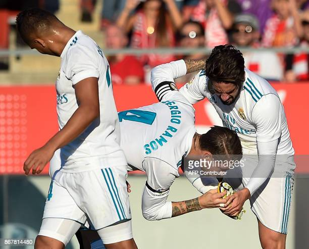 Real Madrid's Spanish defender Sergio Ramos congratulates Real Madrid's Spanish midfielder Isco after scoring a goal during the Spanish league...