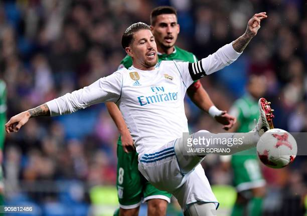 Real Madrid's Spanish defender Sergio Ramos controls the ball beside Leganes' Brazilian midfielder Gabriel Appelt during the Spanish 'Copa del Rey'...