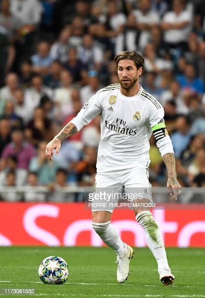 Real Madrid's Spanish defender Sergio Ramos dribbles the ball during the UEFA Champions league Group A football match between Real Madrid and Club...