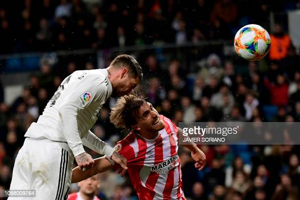 Real Madrid's Spanish defender Sergio Ramos heads the ball and scores during the Spanish Copa del Rey quarterfinal first leg football match between...