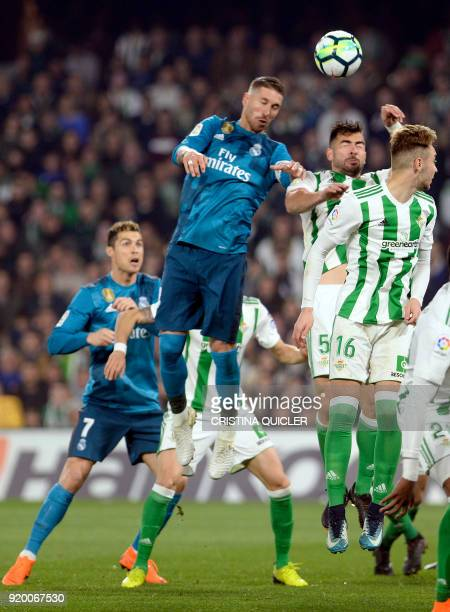 Real Madrid's Spanish defender Sergio Ramos heads the ball to score a goal during the Spanish league football match Real Betis vs Real Madrid at the...