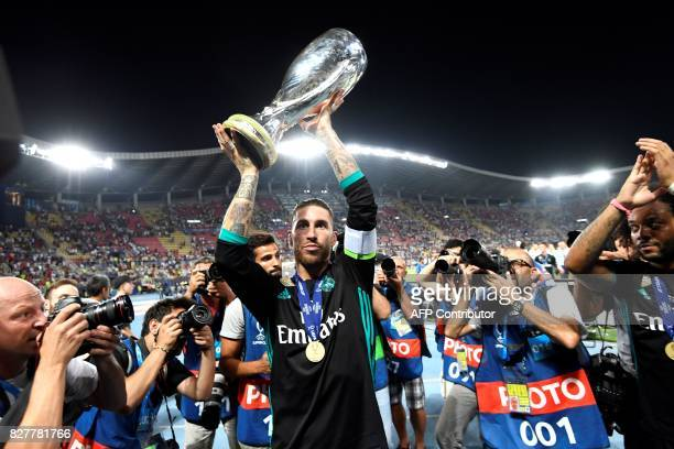 TOPSHOT Real Madrid's Spanish defender Sergio Ramos holds the trophy after winning the UEFA Super Cup football match between Real Madrid and...