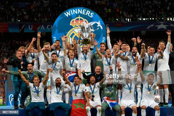 TOPSHOT Real Madrid's Spanish defender Sergio Ramos holds the trophy after winning the UEFA Champions League final football match between Liverpool...
