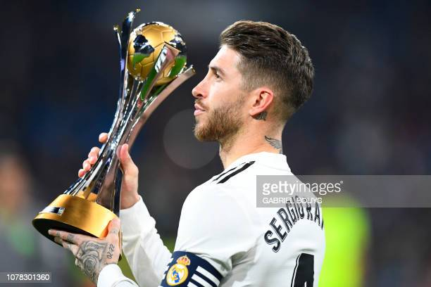 Real Madrid's Spanish defender Sergio Ramos holds the winner's trophy of the 2018 FIFA Club World Cup before the Spanish League football match...