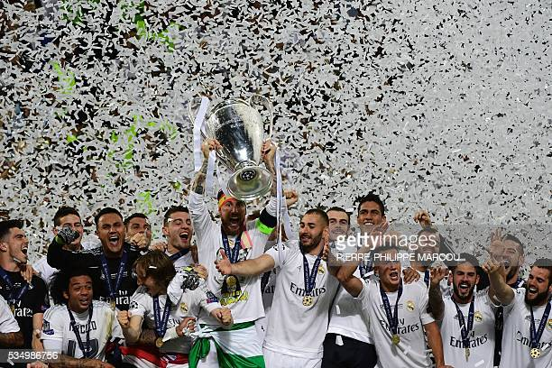 Real Madrid's Spanish defender Sergio Ramos lifts the trophy after Real Madrid won the UEFA Champions League final football match between Real Madrid...