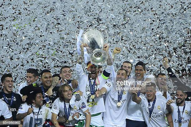 Real Madrid's Spanish defender Sergio Ramos lifts the trophy as Real Madrid players celebrate winning the UEFA Champions League final football match...