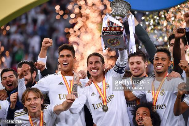 TOPSHOT Real Madrid's Spanish defender Sergio Ramos raises the cup as the players celebrate winning the Spanish Super Cup final between Real Madrid...