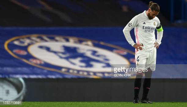 Real Madrid's Spanish defender Sergio Ramos reacts after conceding a second goal during the UEFA Champions League second leg semi-final football...