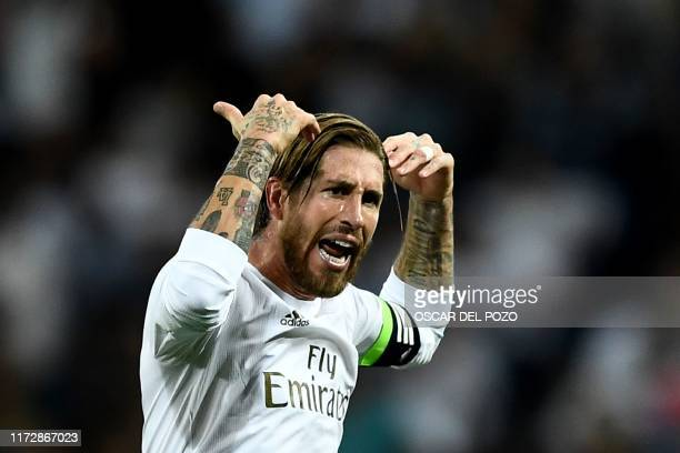 Real Madrid's Spanish defender Sergio Ramos reacts after scoring during the UEFA Champions league Group A football match between Real Madrid and Club...