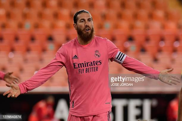 Real Madrid's Spanish defender Sergio Ramos reacts during the Spanish League football match between Valencia and Real Madrid at the Mestalla stadium...