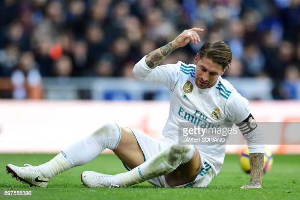 Real Madrid's Spanish defender Sergio Ramos reacts during the Spanish League 'Clasico' football match Real Madrid CF vs FC Barcelona at the Santiago...