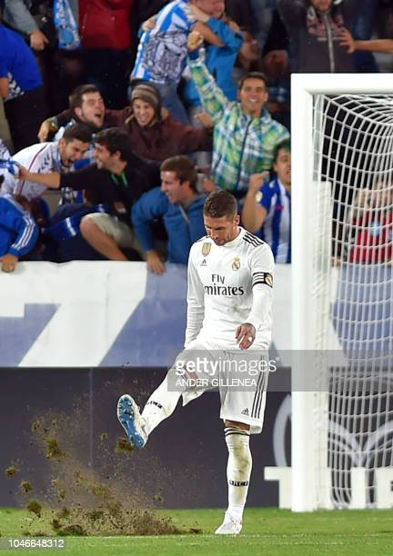 Real Madrid's Spanish defender Sergio Ramos reacts kicking the field to Alaves' score during the Spanish league football match between Deportivo...