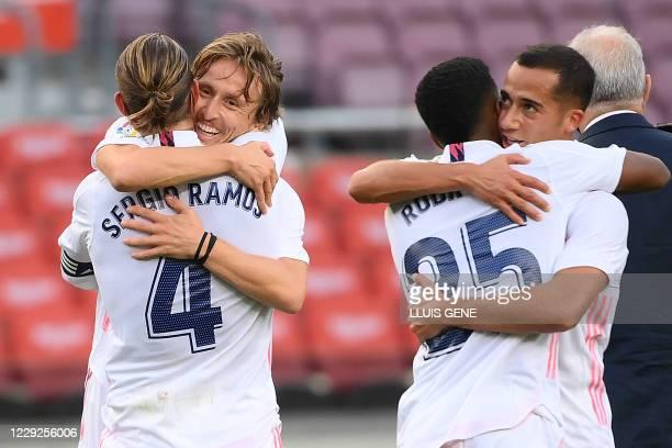 Real Madrid's Spanish defender Sergio Ramos, Real Madrid's Croatian midfielder Luka Modric, Real Madrid's Brazilian forward Rodrygo and Real Madrid's...