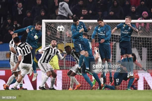 TOPSHOT Real Madrid's Spanish defender Sergio Ramos Real Madrid's Portuguese forward Cristiano Ronaldo Real Madrid's French defender Raphael Varane...